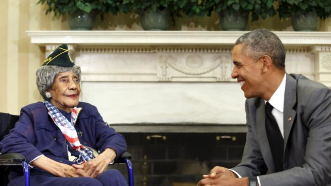 U.S. President Barack Obama smiles with Emma Didlake, the oldest known World War II veteran at 110 years old, in the the Oval Office of the White House in Washington July 17, 2015. Didlake was a Private during the course of her service and her decorations include the Women's Army Corps Service Medal, American Campaign Medal, and World War II Victory Medal. She is visiting Washington, D.C., for her Honor Flight, provided by the Honor Flight Network. REUTERS/Yuri Gripas