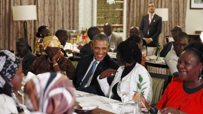 U.S. President Barack Obama attends a private dinner with family members at his hotel restaurant after arriving in Nairobi July 24, 2015. U.S. President Barack Obama flew into Kenya late on Friday for his first presidential visit to his father's homeland, aiming to boost trade and security ties. REUTERS/Jonathan Ernst