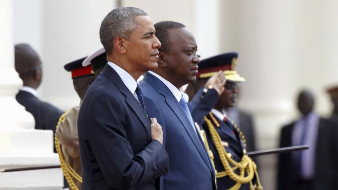 REFILE - REMOVING EXTRA WORDS U.S. President Barack Obama (L) takes part in a reception ceremony next to Kenya's President Uhuru Kenyatta (R) as he visits the State House in Kenya's capital Nairobi, July 25, 2015. Obama told African entrepreneurs in Kenya on Saturday they could help counter violent ideologies and drive growth in Africa, and said governments had to assist by ensuring the rule of law was upheld and by tackling corruption.  REUTERS/Thomas Mukoya