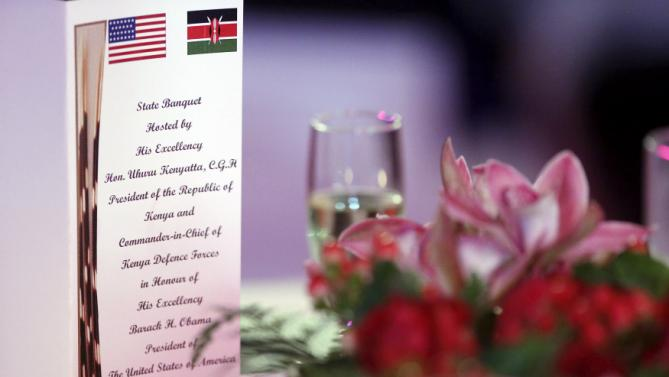 A program sits on a table as U.S. President Barack Obama and Kenya's President Uhuru Kenyatta (not pictured) deliver toasts at the end of a state dinner in Obama's honor at the State House in Nairobi July 25, 2015. Obama told African entrepreneurs in Kenya on Saturday they could help counter violent ideologies and drive growth in Africa, and said governments had to assist by ensuring the rule of law was upheld and by tackling corruption. REUTERS/Jonathan Ernst