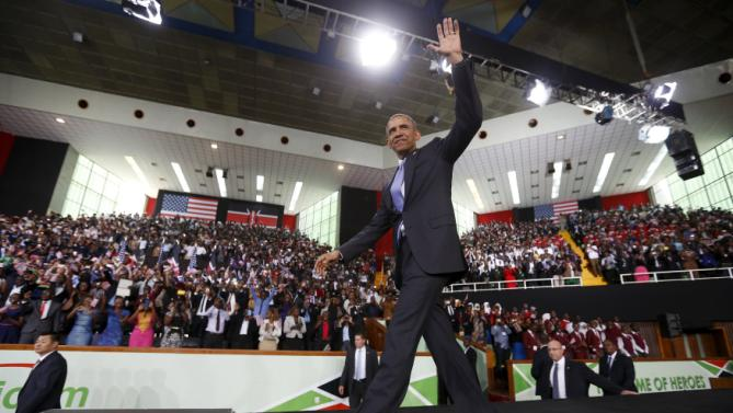U.S. President Barack Obama takes the stage to deliver remarks at an indoor stadium in Nairobi July 26, 2015. Obama told Kenya on Saturday the United States was ready to work more closely in the battle against Somalia's Islamist group al Shabaab, but chided his host on gay rights and said no African state should discriminate over sexuality. REUTERS/Jonathan Ernst