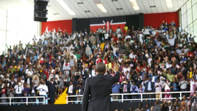 U.S. President Barack Obama waves to the crowd as he departs after his remarks at an indoor stadium in Nairobi July 26, 2015. Obama told Kenya on Saturday the United States was ready to work more closely in the battle against Somalia's Islamist group al Shabaab, but chided his host on gay rights and said no African state should discriminate over sexuality. REUTERS/Jonathan Ernst
