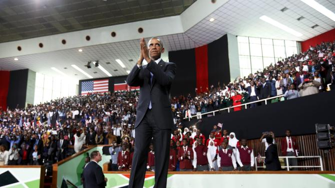U.S. President Barack Obama thanks the crowd as he departs after his remarks at an indoor stadium in Nairobi July 26, 2015. Obama told Kenya on Saturday the United States was ready to work more closely in the battle against Somalia's Islamist group al Shabaab, but chided his host on gay rights and said no African state should discriminate over sexuality. REUTERS/Jonathan Ernst