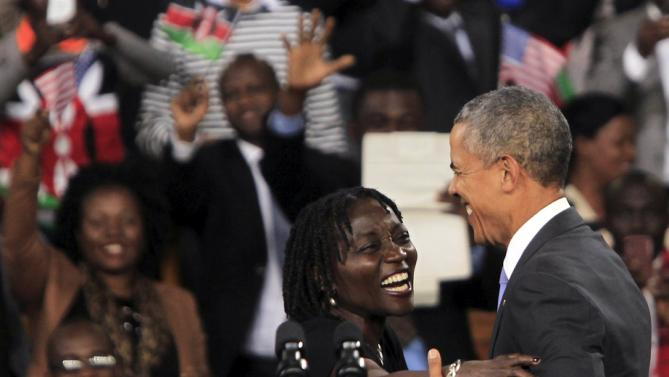 "Auma Obama (L) hugs her half-brother U.S. President Barack Obama (R)  during an event at an indoor stadium in Nairobi July 26, 2015. Obama told Kenyans on Sunday on his first presidential trip to his father's homeland that there was ""no limit to what you can achieve"" but said they had to deepen democracy, tackle corruption and end exclusion based on gender or ethnicity. REUTERS/Noor Khamis"