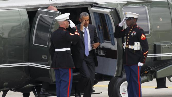 U.S. President Barack Obama disembarks Marine One as he arrives at Jomo Kenyatta International Airport in Nairobi to leave for Ethiopia aboard Air Force One July 26, 2015. Obama told Kenyans on Sunday on his first presidential trip to his father's homeland that there was