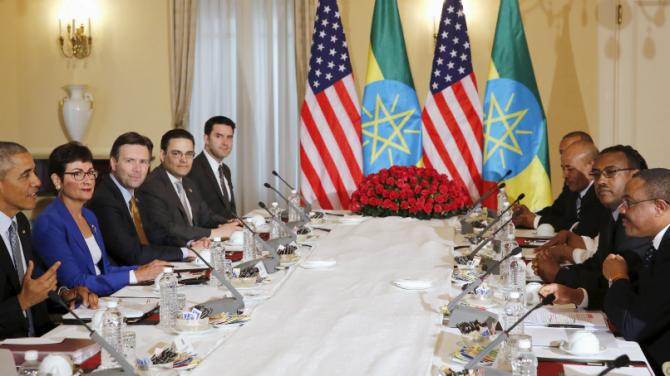 REFILE - UPDATING SLUG U.S. President Barack Obama (L) and his delegation sit down to a bilateral meeting with Ethiopia's Prime Minister Hailemariam Desalegn (R) at the National Palace in Addis Ababa, Ethiopia July 27, 2015. The economy of Ethiopia is forecast to expand by more than 10 percent, although rights groups say Addis Ababa's achievements are at the expense of political freedom. REUTERS/Jonathan Ernst