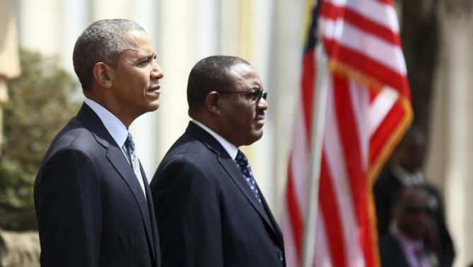 U.S. President Barack Obama (L) takes part in a welcome ceremony with Ethiopia's Prime Minister Hailemariam Desalegn (R) at the National Palace in Addis Ababa, Ethiopia July 27, 2015. The economy of Ethiopia is forecast to expand by more than 10 percent, although rights groups say Addis Ababa's achievements are at the expense of political freedom.REUTERS/Tiksa Negeri