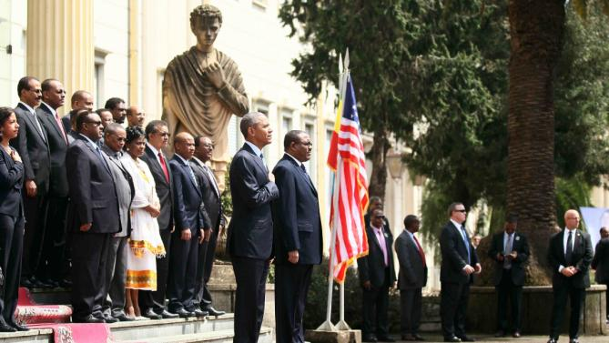 U.S. President Barack Obama (C) and his delegation, stand during welcome ceremony with Ethiopia's Prime Minister Hailemariam Desalegn (R) at the National Palace in Addis Ababa, Ethiopia July 27, 2015. The economy of Ethiopia is forecast to expand by more than 10 percent, although rights groups say Addis Ababa's achievements are at the expense of political freedom.REUTERS/Tiksa Negeri