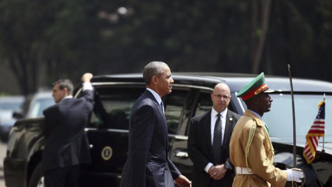 U.S. President Barack Obama (C) walks to review a marsh band during a welcome ceremony at the National Palace in Addis Ababa, Ethiopia July 27, 2015. The economy of Ethiopia is forecast to expand by more than 10 percent, although rights groups say Addis Ababa's achievements are at the expense of political freedom. REUTERS/Tiksa Negeri