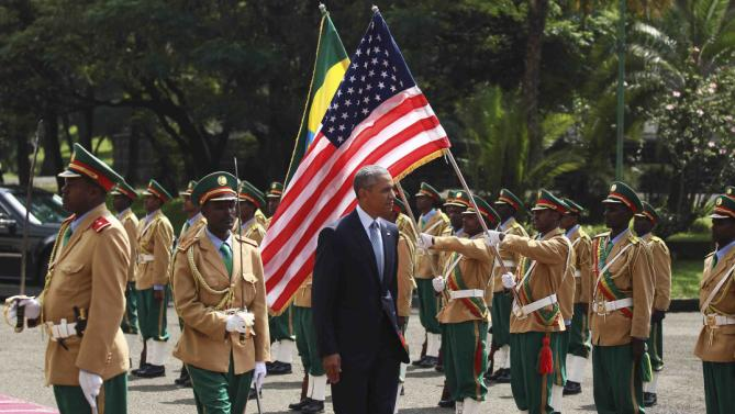 U.S. President Barack Obama (C) reviews a marsh band during a welcome ceremony at the National Palace in Addis Ababa, Ethiopia July 27, 2015. The economy of Ethiopia is forecast to expand by more than 10 percent, although rights groups say Addis Ababa's achievements are at the expense of political freedom. REUTERS/Tiksa Negeri