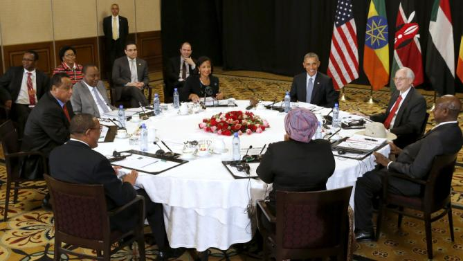 U.S. President Barack Obama holds a meeting on South Sudan and counterterrorism issues with African heads of state at his hotel in Addis Ababa, Ethiopia July 27, 2015. Pictured at the table are: Obama (clockwise from the top center), U.S. Special Envoy to Sudan and South Sudan Donald Booth, Uganda's President Yoweri Museveni, African Union Chairperson Dlamini Zuma, Ethiopia's Prime Minister Hailemariam Desalegn, Sudan's Minister of Foreign Affairs Ibrahim Ghandour, Kenya's President Uhuru Kenyatta and U.S. National Security Advisor Susan Rice. REUTERS/Jonathan Ernst