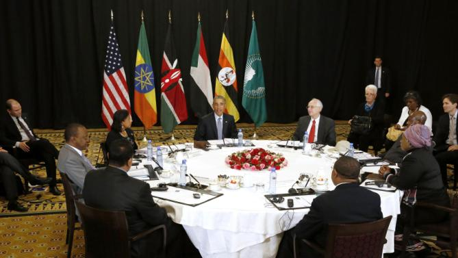 U.S. President Barack Obama (C) holds a meeting on South Sudan and counterterrorism issues with African heads of state at his hotel in Addis Ababa, Ethiopia July 27, 2015. Pictured at the table (clockwise from the top center), are: Obama, U.S. Special Envoy to Sudan and South Sudan Donald Booth, Uganda's President Yoweri Museveni, African Union Chairperson Dlamini Zuma, Ethiopiaâ's Prime Minister Hailemariam Desalegn, Sudan's Minister of Foreign Affairs Ibrahim Ghandour, Kenya's President Uhuru Kenyatta and U.S. National Security Advisor Susan Rice. REUTERS/Jonathan Ernst