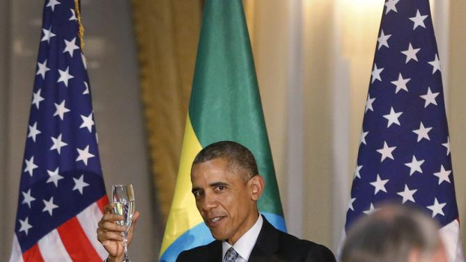 U.S. President Barack Obama raises his glass in a toast during a State Dinner in his honor at the National Palace in Addis Ababa, Ethiopia July 27, 2015. REUTERS/Jonathan Ernst