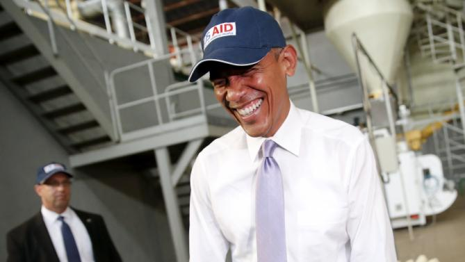 U.S. President Barack Obama laughs after commenting on his press corps, who were wearing hair nets on a tour of the Faffa Food factory in Addis Ababa, Ethiopia July 28, 2015. Obama told Ethiopia's leaders on Monday that allowing more political freedoms would strengthen the African nation, which had already lifted millions out of a poverty once rooted in recurring famine. REUTERS/Jonathan Ernst