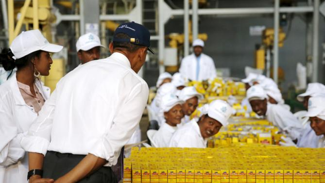 U.S. President Barack Obama (2nd L) bows as he greets workers during a tour of the Faffa Food factory in Addis Ababa, Ethiopia July 28, 2015. Obama told Ethiopia's leaders on Monday that allowing more political freedoms would strengthen the African nation, which had already lifted millions out of a poverty once rooted in recurring famine. REUTERS/Jonathan Ernst