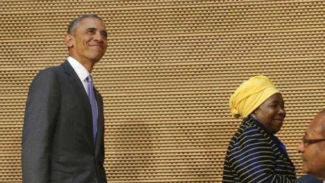 U.S. President Barack Obama (top L) smiles as he arrives with African Union Chairperson Nkosazana Dlamini-Zuma (top R) to deliver remarks at the African Union in Addis Ababa, Ethiopia July 28, 2015. Obama toured a U.S.-supported food factory in Ethiopia on Tuesday on the last leg of an Africa trip, before winding up his visit at the African Union where he will become the first U.S. president to address the 54-nation body.   REUTERS/Jonathan Ernst