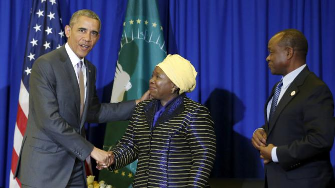U.S. President Barack Obama (L) meets with African Union Chairperson Nkosazana Dlamini-Zuma (C) at the African Union in Addis Ababa, Ethiopia July 28, 2015. Obama toured a U.S.-supported food factory in Ethiopia on Tuesday on the last leg of an Africa trip, before winding up his visit at the African Union where he will become the first U.S. president to address the 54-nation body.  REUTERS/Jonathan Ernst