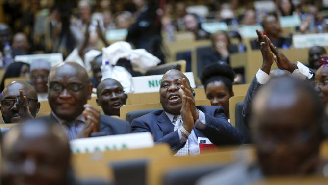 Delegates react to remarks by U.S. President Barack Obama at the African Union in Addis Ababa, Ethiopia July 28, 2015. Obama toured a U.S.-supported food factory in Ethiopia on Tuesday on the last leg of an Africa trip, before winding up his visit at the African Union where he will become the first U.S. president to address the 54-nation body. REUTERS/Jonathan Ernst