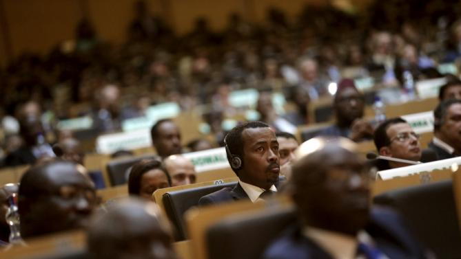 Delegates listen to remarks by U.S. President Barack Obama at the African Union in Addis Ababa, Ethiopia July 28, 2015. Obama toured a U.S.-supported food factory in Ethiopia on Tuesday on the last leg of an Africa trip, before winding up his visit at the African Union where he will become the first U.S. president to address the 54-nation body.  REUTERS/Jonathan Ernst