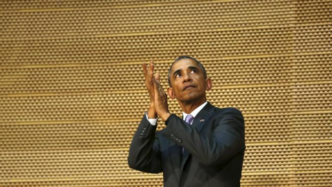 U.S. President Barack Obama applauds the assembly at the end of his remarks to the African Union in Addis Ababa, Ethiopia July 28, 2015. Obama toured a U.S.-supported food factory in Ethiopia on Tuesday on the last leg of an Africa trip, before winding up his visit at the African Union where he will become the first U.S. president to address the 54-nation body. REUTERS/Jonathan Ernst