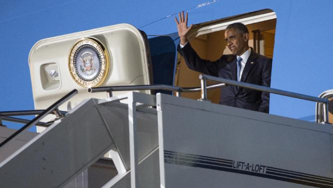 President Barack Obama waves as he arrives at Kenyatta International Airport, on Friday, July 24, 2015, in Nairobi, Kenya. Obama is traveling on a two-nation African tour where he will become the the first sitting U.S. president to visit Kenya and Ethiopia. (AP Photo/Evan Vucci)