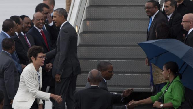 US President Barack Obama, centre left, shakse hands with members of the Ethiopian delegation as he departs Bole International Airport, Tuesday, July 28, 2015, in Addis Ababa, on the final day of his visit in Ethiopia. Closing a historic visit to Africa, President Barack Obama on Tuesday urged the continent's leaders to prioritize creating jobs and opportunity for the next generation of young people or risk sacrificing future economic potential to further instability and disorder. (AP Photo/Sayyid Azim)