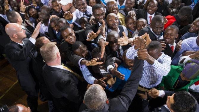 President Barack Obama, bottom center, shakes hands after delivering a speech at Safaricom Indoor Arena, Sunday, July 26, 2015, in Nairobi. On the final day of his visit in Kenya, Obama laid out his vision for Kenya's future, and broad themes of U.S.-Kenya relations. (AP Photo/Evan Vucci)