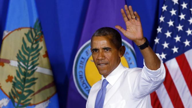 President Barack Obama waves as he arrives to speak at Durant High School in Durant, Okla., Wednesday, July 15, 2015. (AP Photo/Sue Ogrocki)