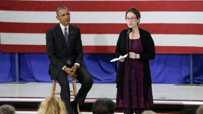 President Barack Obama listens as Kelly Bryant, right, a breast cancer survivor, introduces Obama at Taylor Stratton Elementary School Wednesday, July 1, 2015, in Nashville, Tenn. The president is in Nashville to speak about the Affordable Care Act. Bryant wrote to the president earlier this year to relay her positive experience with the Affordable Care Act. (AP Photo/Mark Humphrey)