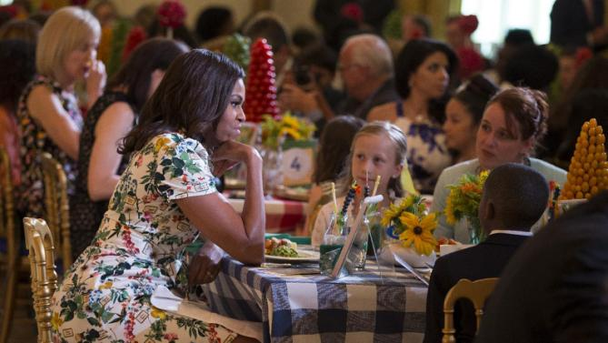 First lady Michelle Obama talks with guests during the Kids State Dinner for the 2015 winners of the Healthy Lunchtime Challenge, on Friday, July 10, 2015, in Washington. (AP Photo/Evan Vucci)