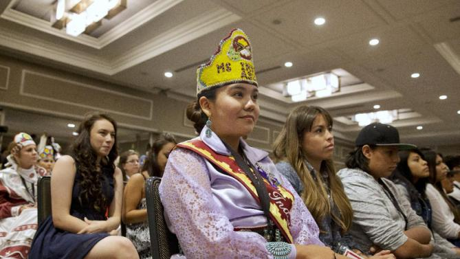 "Brooke Overturf, of the Navajo Nation from Window Rock, Ariz., listens to first lady Michelle Obama speak at the first White House Tribal Youth Gathering, Thursday, July 9, 2015 in Washington. Obama told hundreds of Native American youths that they are all precious and sacred and that ""each of you was put on this earth for a reason.""(AP Photo/Jacquelyn Martin)"