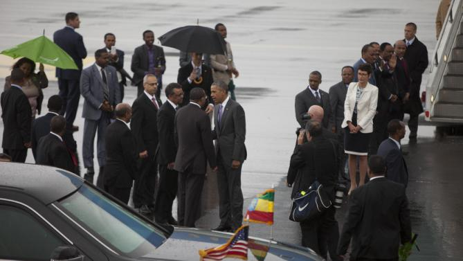 US President Barack Obama, centre, shakes hands with members of the Ethiopian delegation as he departs Bole International Airport, Tuesday, July 28, 2015, in Addis Ababa, on the final day of his visit in Ethiopia. Closing a historic visit to Africa, President Barack Obama on Tuesday urged the continent's leaders to prioritize creating jobs and opportunity for the next generation of young people or risk sacrificing future economic potential to further instability and disorder. (AP Photo/Sayyid Azim)
