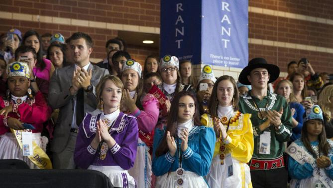 Spectators applaud as President Barack Obama speaks in the Choctaw Nation on economic opportunities for underprivileged communities across the nation, on Wednesday, July 15, 2015, in Durant, Okla. (AP Photo/Evan Vucci)