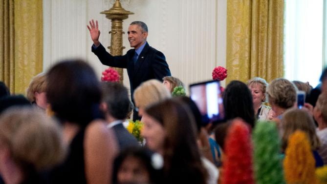 President Barack Obama makes an unannounced appearance as first lady Michelle Obama hosts the 2015 winners of the Healthy Lunchtime Challenge for the Kids' State Dinner in the East Room at the White House, Friday, July 10, 2015, in Washington. (AP Photo/Andrew Harnik)