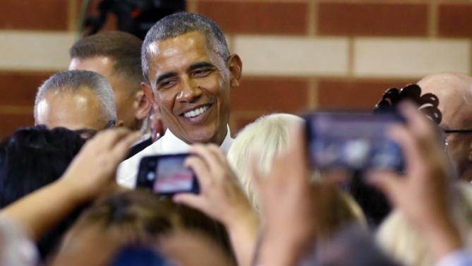 President Barack Obama greets members of the audience after speaking at Durant High School in Durant, Okla., Wednesday, July 15, 2015. (AP Photo/Sue Ogrocki)