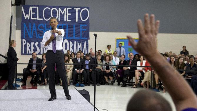 President Barack Obama takes a question from a man in the audience at Taylor Stratton Elementary School in Nashville, Tenn., Wednesday, July 1, 2015, where he spoke about the Affordable Care Act. The president said he wants to refocus on improving health care quality, expanding access and rooting out waste now that the Supreme Court has upheld a key element of his health care law.  (AP Photo/Carolyn Kaster)