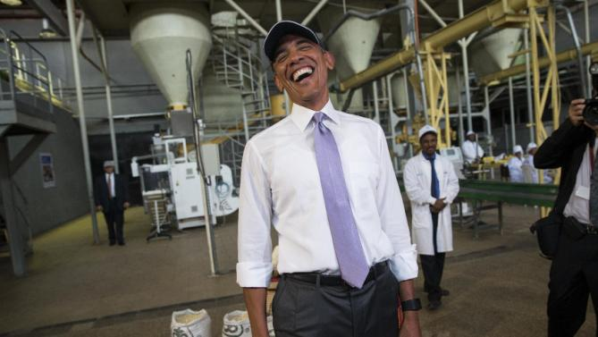 U.S. President Barack Obama jokes with the media during a tour of Faffa Food, Tuesday, July 28, 2015, in Addis Ababa, Ethiopia. On the final day of his African trip, Obama is focusing on economic opportunities and African security. (AP Photo/Evan Vucci)