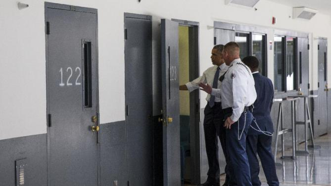 President Barack Obama is led on a tour by Bureau of Prisons Director Charles Samuels, right, and correctional officer Ronald Warlick during a visit to the El Reno Federal Correctional Institution, in El Reno, Okla., Thursday, July 16, 2015. As part of a weeklong focus on inequities in the criminal justice system, the president will meet separately Thursday with law enforcement officials and nonviolent drug offenders who are paying their debt to society at the El Reno Federal Correctional Institution, a medium-security prison for male offenders near Oklahoma City. (AP Photo/Evan Vucci)