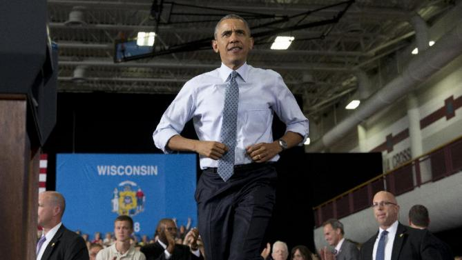 President Barack Obama arrives to speaks at the University of Wisconsin at La Crosse, in La Crosse, Wis., Thursday, July 2, 2015, about the economy and to promote a proposed Labor Department rule that would make more workers eligible for overtime. (AP Photo/Carolyn Kaster)