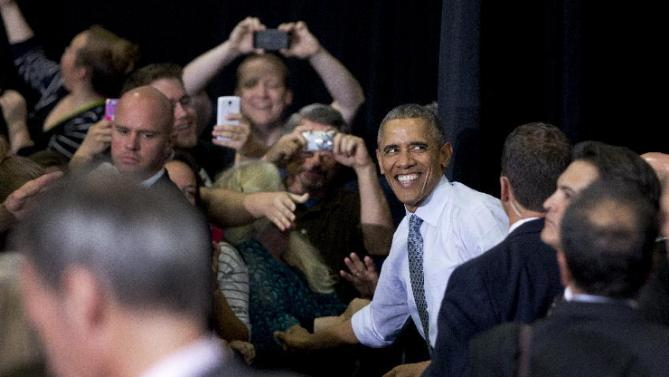 President Barack Obama greets people in the audience after speaking at the University of Wisconsin at La Crosse, in La Crosse, Wis., Thursday, July 2, 2015, about the economy and to promote a proposed Labor Department rule that would make more workers eligible for overtime. (AP Photo/Carolyn Kaster)