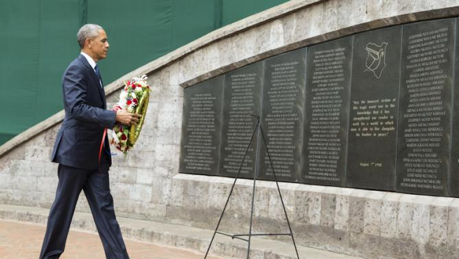 President Barack Obama participates in a wreath laying ceremony, Saturday, July 25, 2015, in Nairobi, at Memorial Park in honor of the victims of the deadly 1998 bombing at the U.S. Embassy.  Obama's visit to Kenya is focused on trade and economic issues, as well as security and counterterrorism cooperation.  (AP Photo/Evan Vucci)