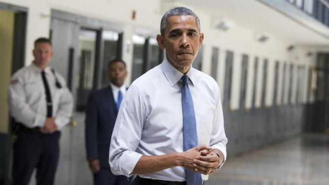 President Barack Obama pauses as he speaks at the El Reno Federal Correctional Institution in El Reno, Okla., Thursday, July 16, 2015. As part of a weeklong focus on inequities in the criminal justice system, the president will meet separately Thursday with law enforcement officials and nonviolent drug offenders who are paying their debt to society at the El Reno Federal Correctional Institution, a medium-security prison for male offenders near Oklahoma City. (AP Photo/Evan Vucci)