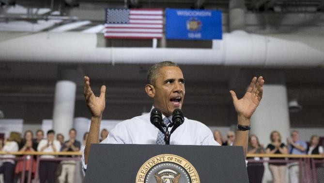 President Barack Obama speaks at the University of Wisconsin at La Crosse, in La Crosse, Wis., Thursday, July 2, 2015, about the economy and to promote a proposed Labor Department rule that would make more workers eligible for overtime. (AP Photo/Carolyn Kaster)
