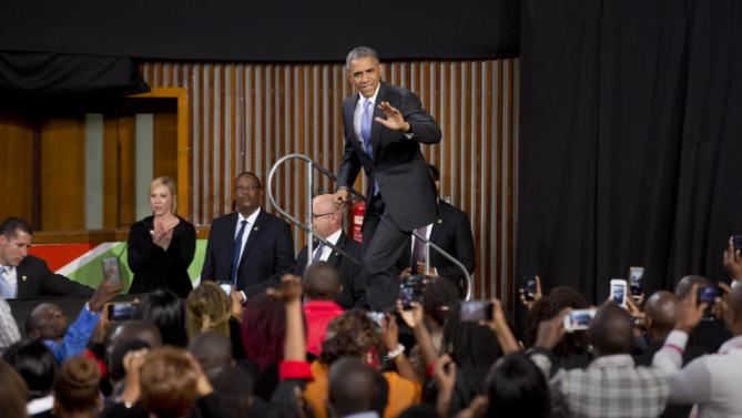 President Barack Obama waves to the crowd as he arrives to give a speech at the Safaricom Indoor Arena in the Kasarani area of Nairobi, Kenya Sunday, July 26, 2015. Obama is traveling on a two-nation African tour where he will become the first sitting U.S. president to visit Kenya and Ethiopia. (AP Photo/Ben Curtis)
