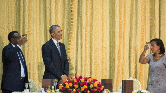Ethiopian Deputy Prime Minister Demeke Mekonnen Hassen, left, and National Security Adviser Susan Rice, right, toast President Barack Obama during a state dinner, Monday, July 27, 2015, at the National Palace in Addis Ababa. Obama is the first sitting U.S. president to visit Ethiopia. (AP Photo/Evan Vucci)
