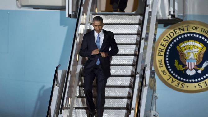 U.S. President Barack Obama descends the steps of Air Force One on his arrival at the Jomo Kenyatta International Airport in Nairobi, Kenya, Friday, July 24, 2015. Obama began his first visit to Kenya as U.S. president Friday. (AP Photo/Ben Curtis)