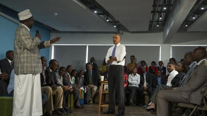 President Barack Obama listens to a question during a meeting with civil society leaders at the YALI Regional Leadership Center, on Sunday, July 26, 2015, in Nairobi. On the final day of his visit in Kenya, Obama laid out his vision for Kenya's future and broad themes of U.S.-Kenya relations. (AP Photo/Evan Vucci)