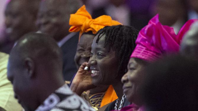 President Barack Obama's half-sister Auma Obama watches as he proposes a toast to Kenyan President Uhuru Kenyatta during a state dinner at State House, on Saturday, July 25, 2015, in Nairobi, Kenya. Obama's visit to Kenya is focused on trade and economic issues, as well as security and counterterrorism cooperation.  (AP Photo/Evan Vucci)