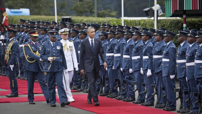 "President Barack Obama inspects the honor guard after arriving to meet with Kenya's President Uhuru Kenyatta at State House in Nairobi, Kenya Saturday, July 25, 2015.  Obama heralded Africa as a continent ""on the move"" while visiting Kenya Saturday, the East African nation where he has deep family ties.(AP Photo/Ben Curtis)"