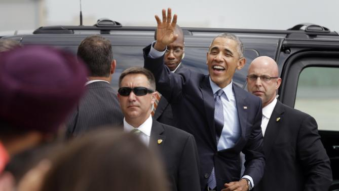 "President Barack Obama waves to supporters as he leaves John. F. Kennedy airport in New York, Tuesday, July 21, 2015. Obama is in New York for a taping of ""The Daily Show"" and a private fundraiser. (AP Photo/Seth Wenig)"